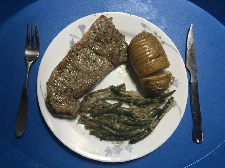 Steak with baked potato and greenbeans