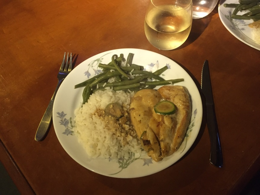 Chicken and rice with white wine sauce and zucchini